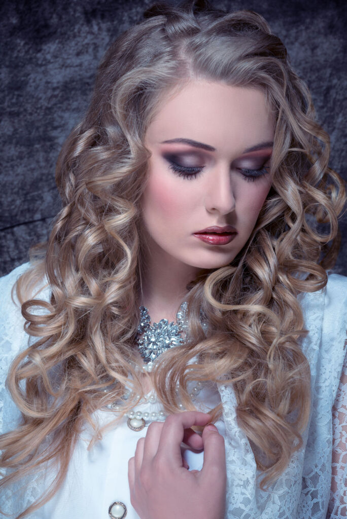 A blonde haired woman wearing some vintage diamond jewellery