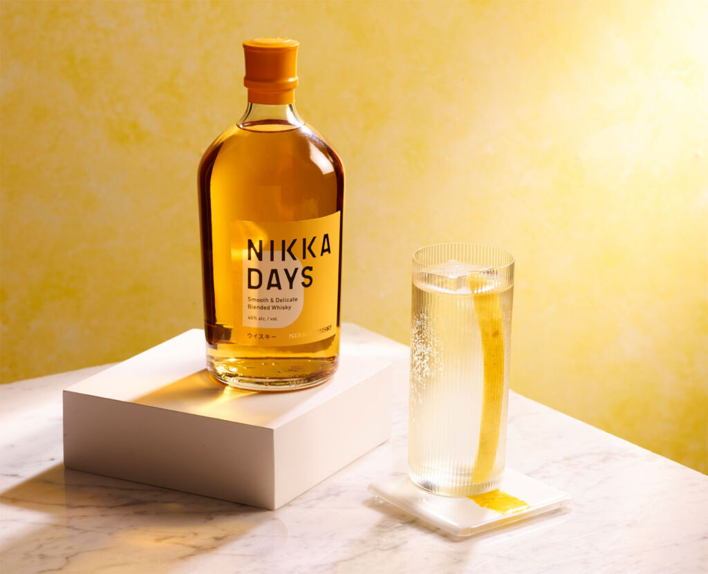 A bottle of Nikka Days with a filled glass