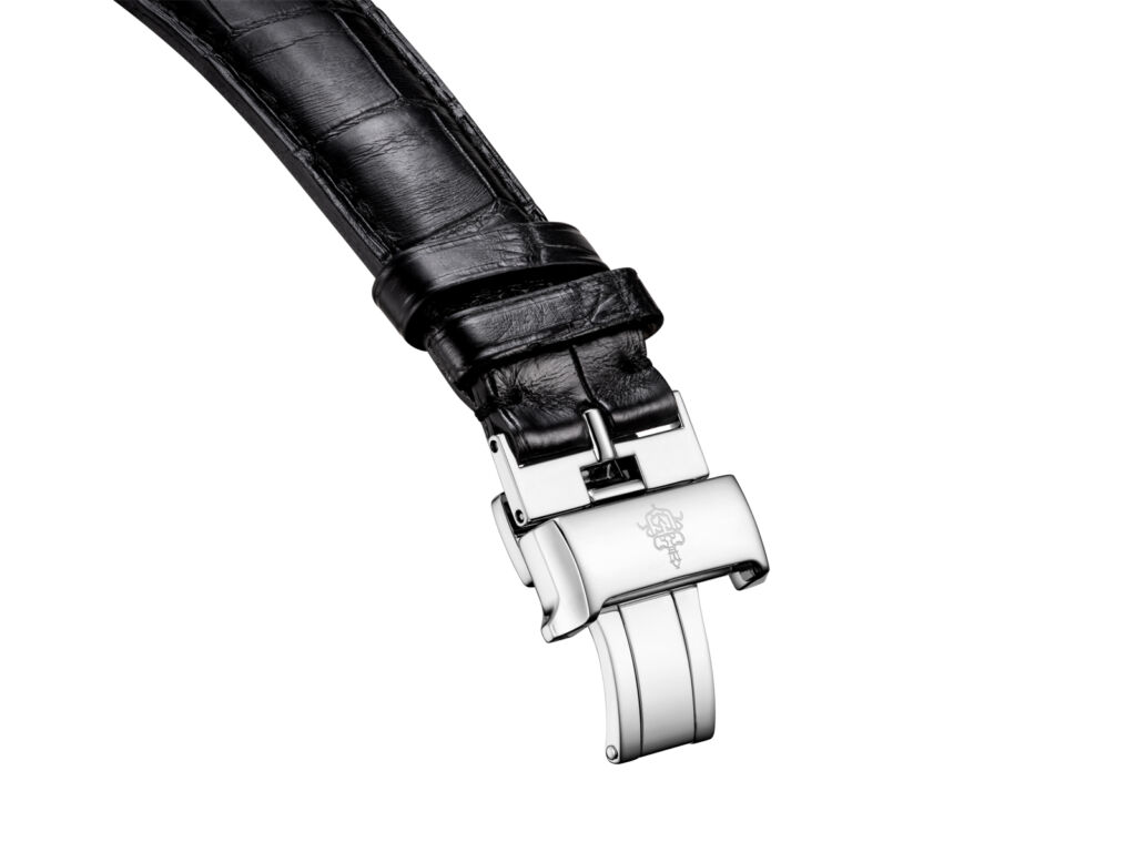 A closeup view of the black alligator strap and clasp