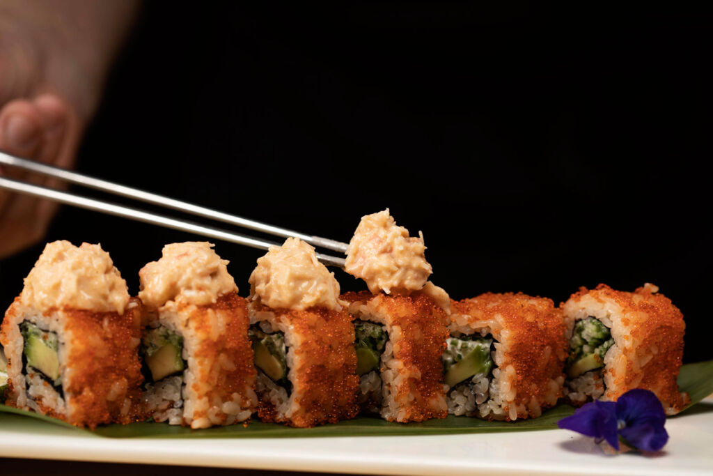 Diners tucking into California Rolls at Chotto Matte Soho