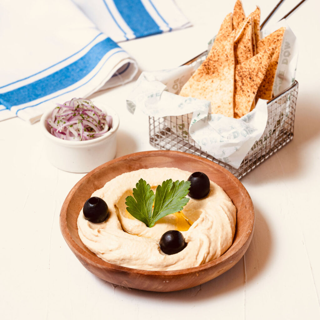 A dish of tasty Hummus with breads