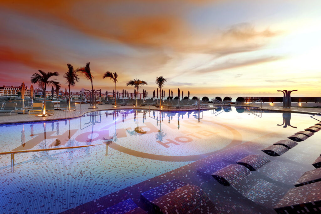 Sunset by the hotel swimming pool
