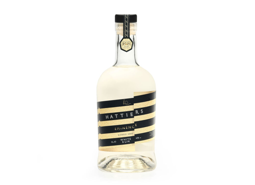The striped labelling on a bottle of Hattiers Eminence Blended Aged White Rum