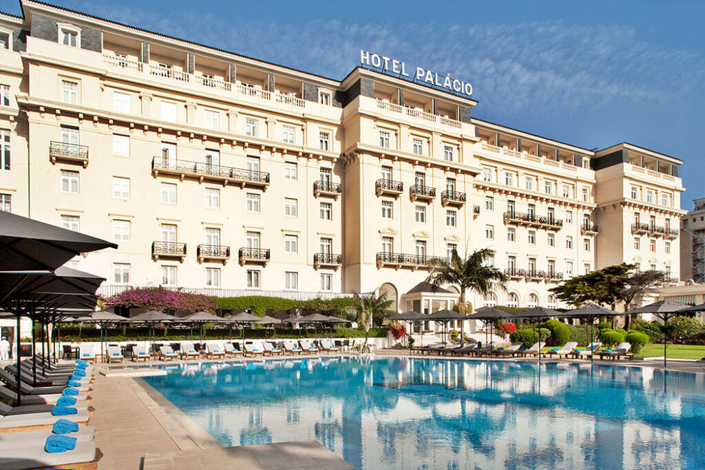 The exterior and main swimming pool at the Hotel Palácio, Estoril