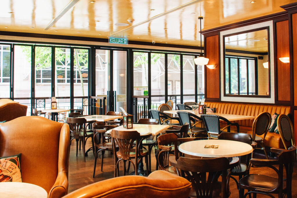 The dining tables and comfy leather seats inside the eatery
