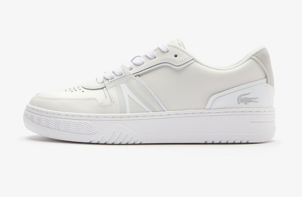 A close up side view of one of the trainers in a white colour