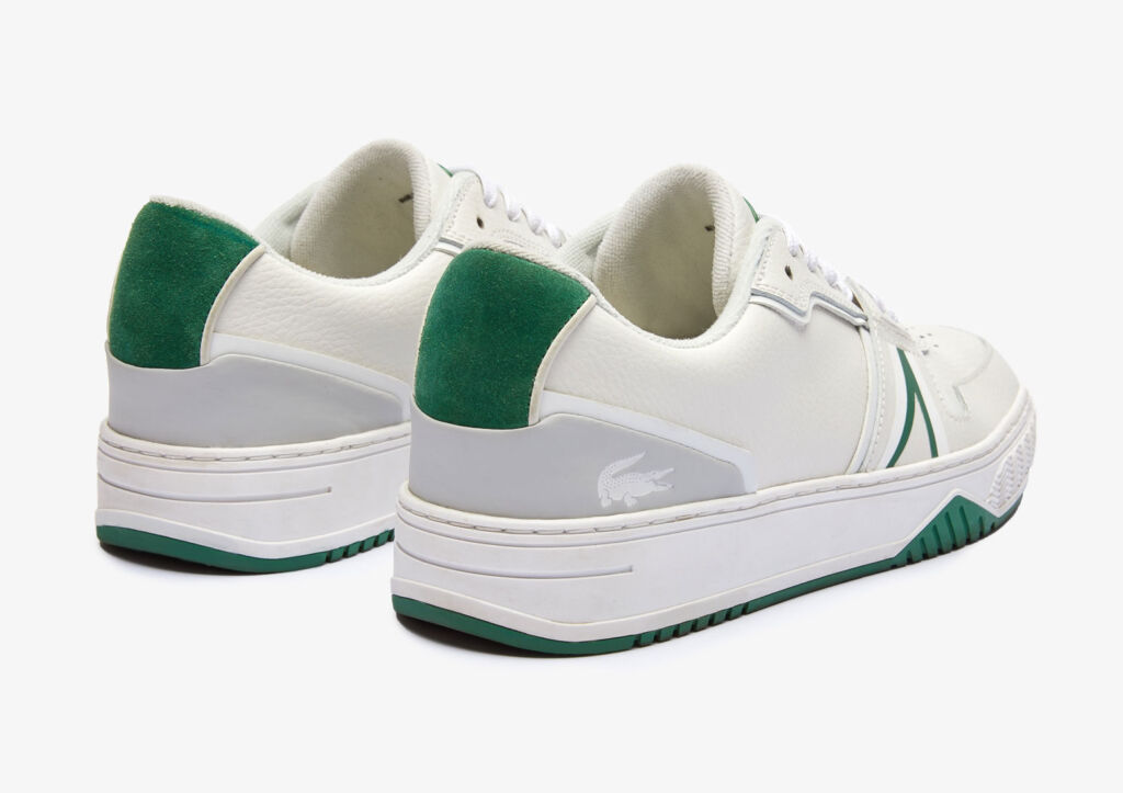 A close up view of a pair of the Lacoste trainers with green accents