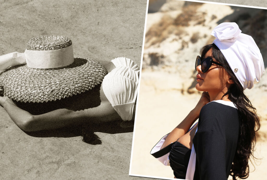 A model laying on a beach under the sun with a hat to cover her face