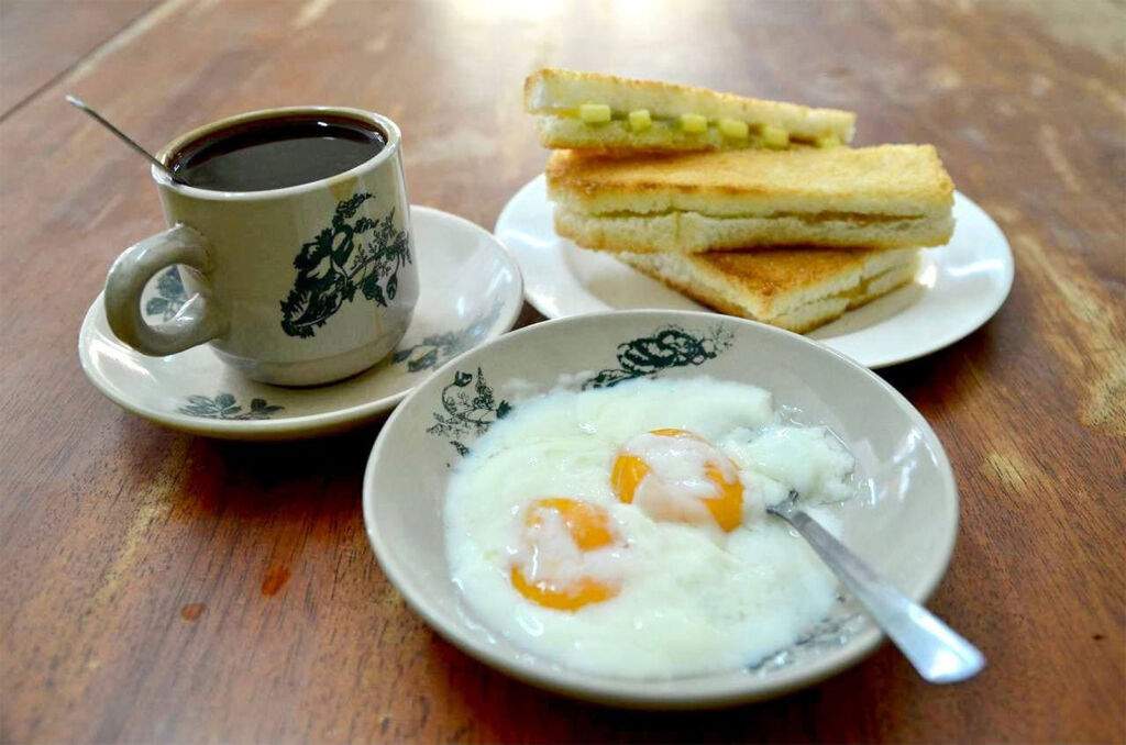 Breakfast at Nam Wah with a bowl of poached eggs, toast and coffee