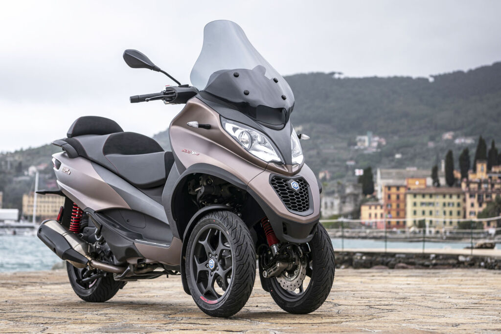 A closeup view of the front of the scooter showing the wheel configuration