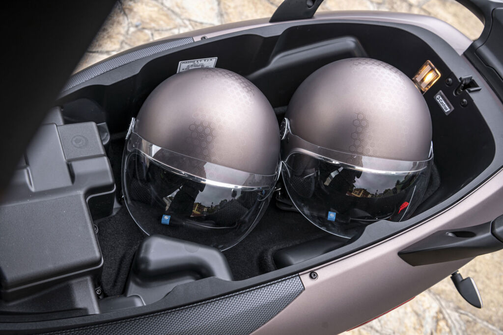 The storage space under the seat which can comfortable store two helmets