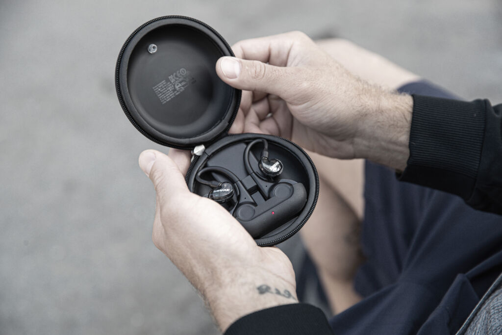 A closeup view of the charging case with the earphones inside