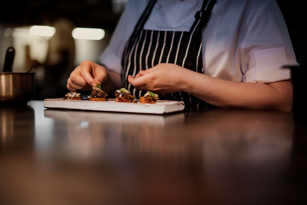 Final preparation and plating before the dish is served