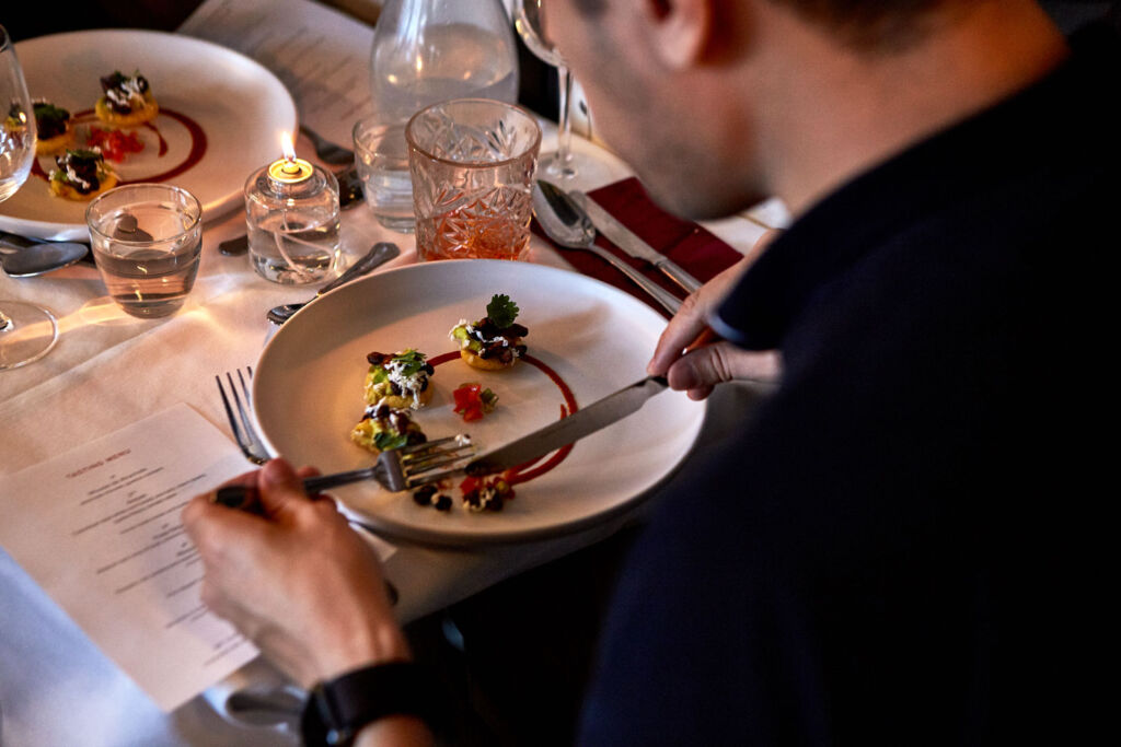A guest eating one of the courses on the tasting menu