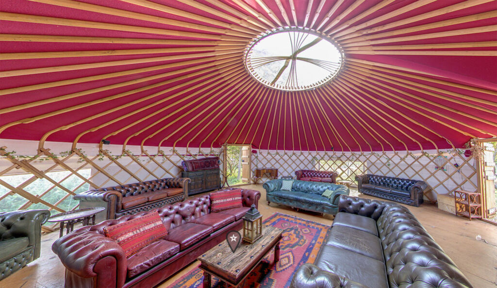 Inside the Home Yurt with its leather Chesterfield sofas
