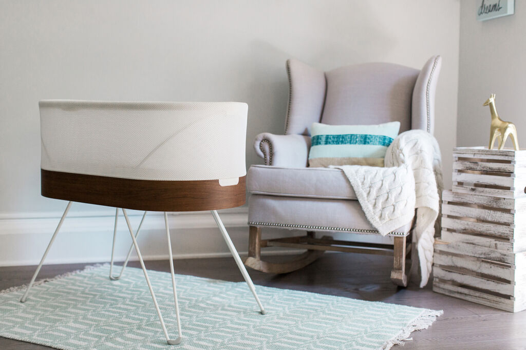 The baby bed in a reception room so one or more of the parents can be close by