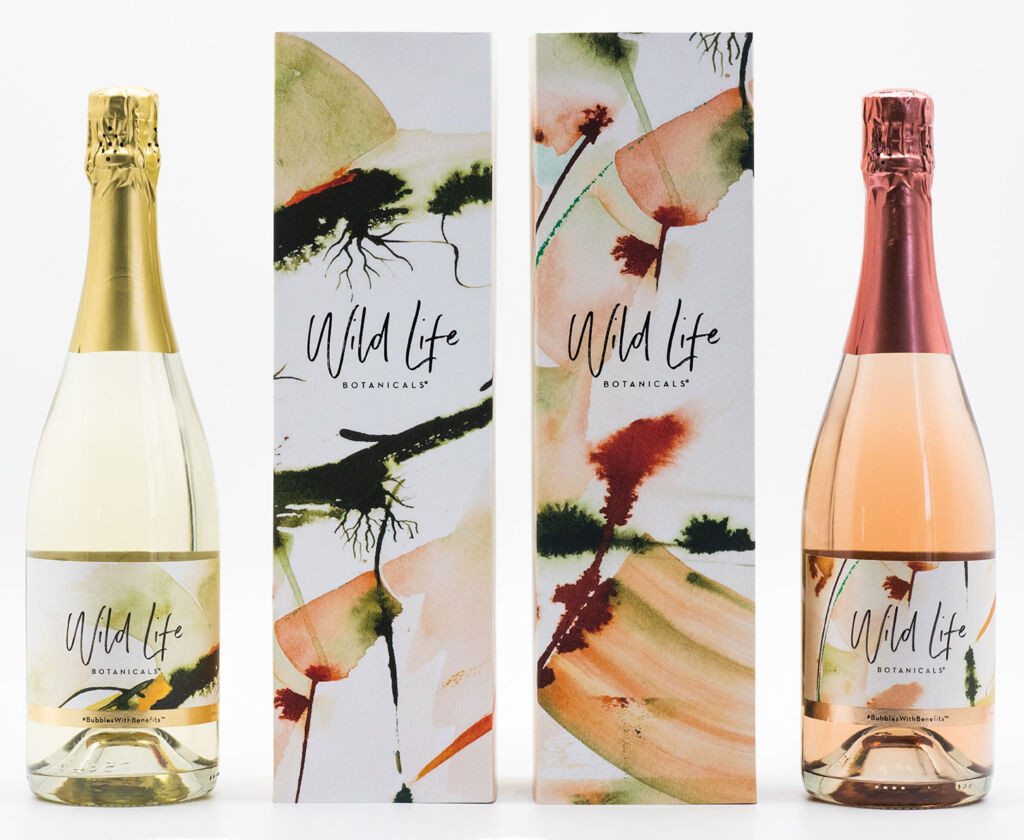 Two bottles of Wild Life Botanicals with their packaging