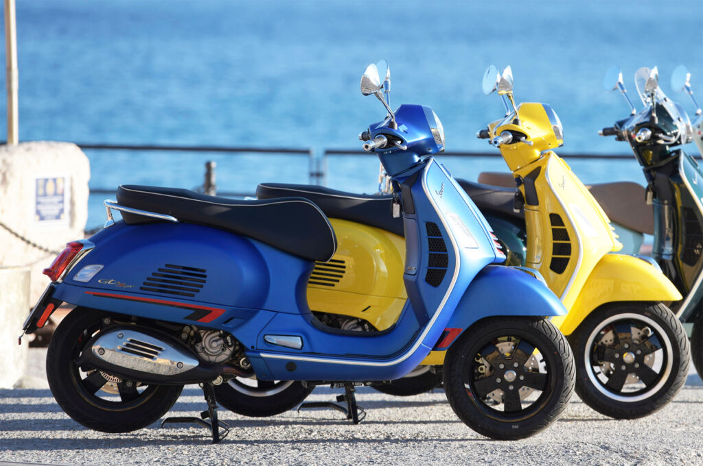 A side view of one of the scooter in blue showing the excellent riding position