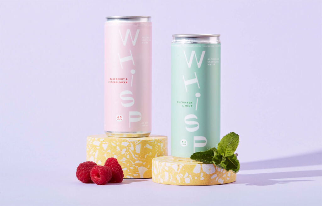 Two of the Whisp cans with fresh fruit
