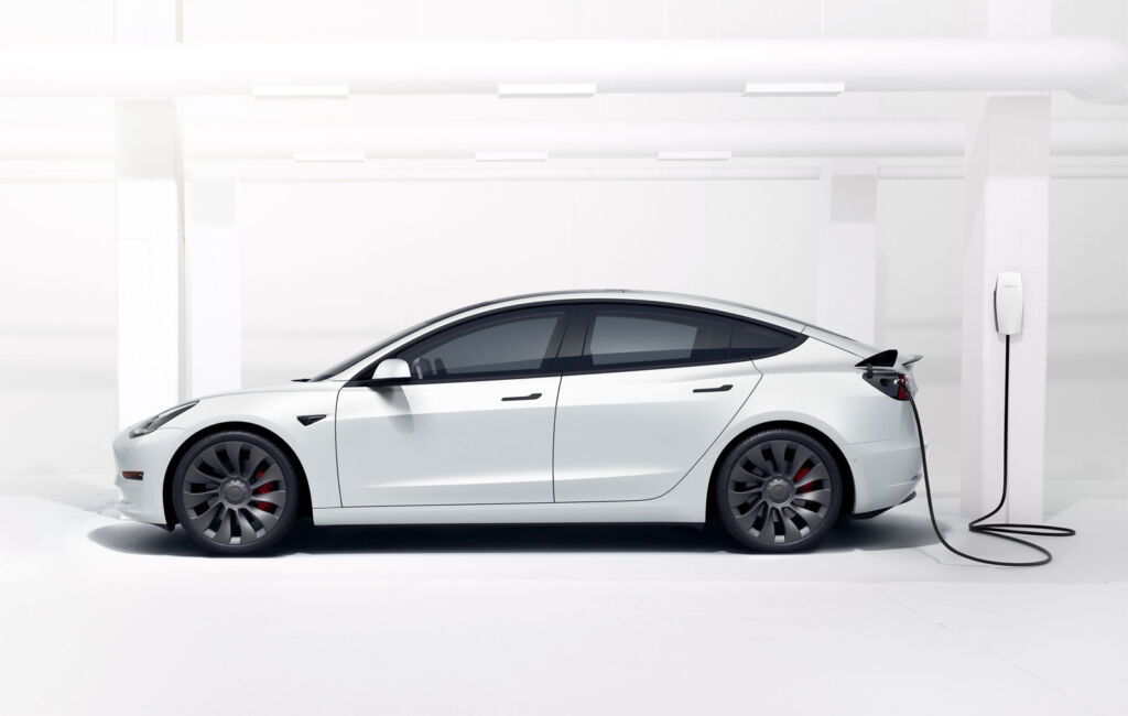 White Tesla Model 3 being charged