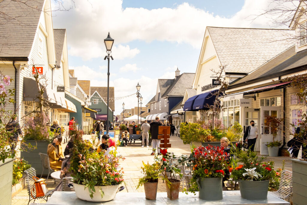 People enjoying a day out exploring Bicester Village