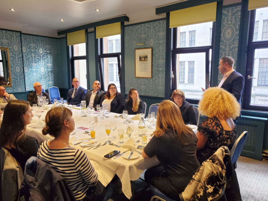 Guests on the tour around a table at the Civil Service Club in Whitehall