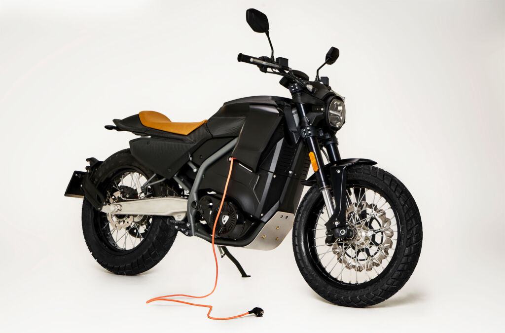 The electric motorcycle with its cable ready to be charged