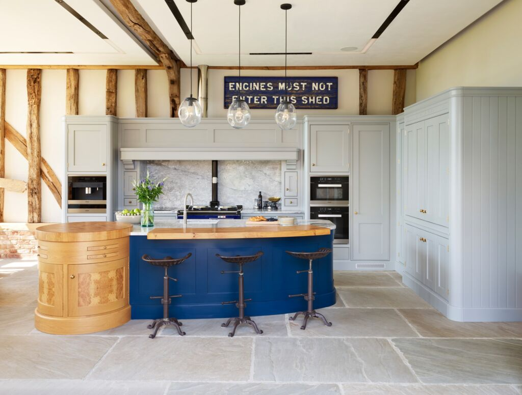 This kitchen shows a great use of colour and how a kitchen island can become a focal point