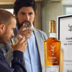 Two men drinking glasses of Glenfiddich presented by MR PORTER