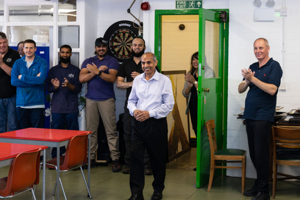Harbans being congratulated by his work colleagues