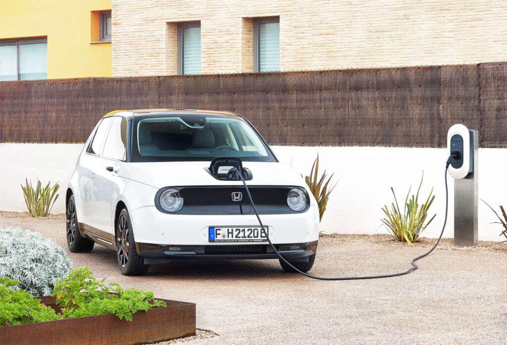 An image showing the car being charged at a residential property
