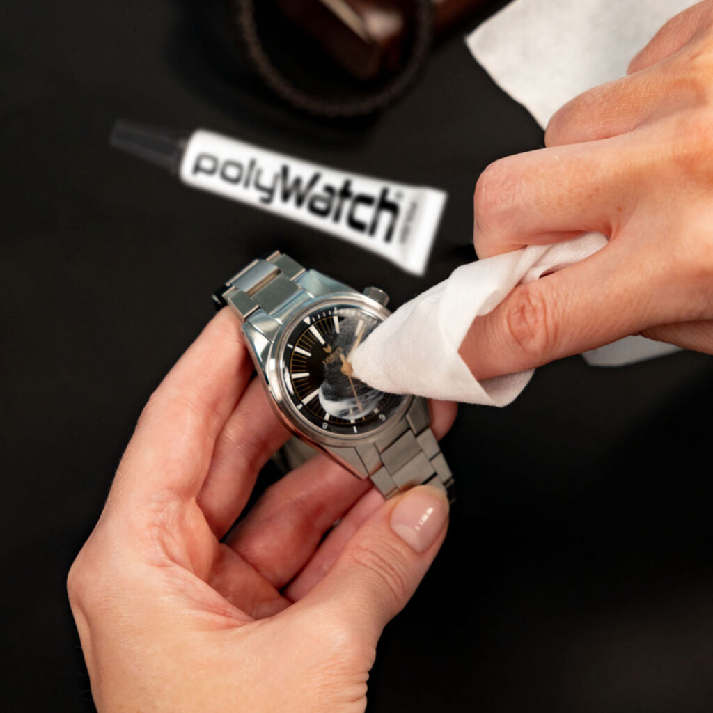 Rubbing the glass polish into the watch face with the supplied wooden rod