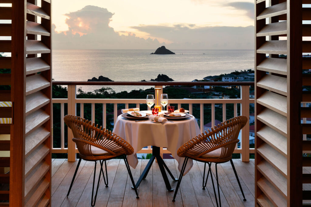 Admiring the views whilst dining on your private balcony overlooking the sea