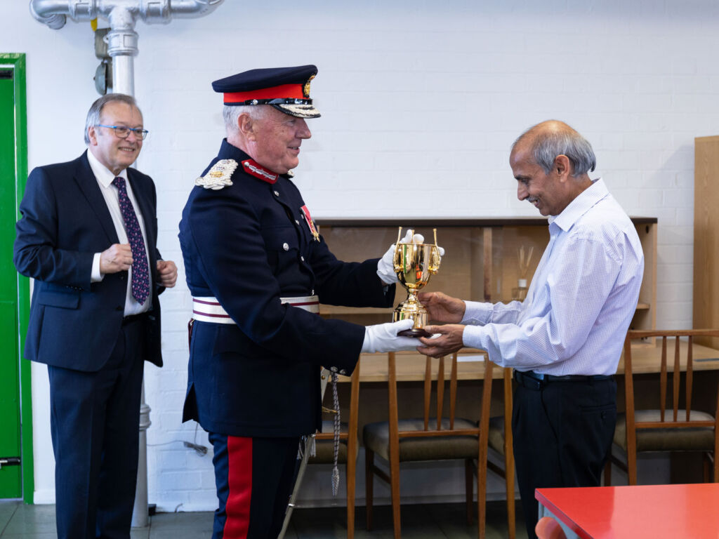Mr Lal being presented with a trophy for 50 years at the company