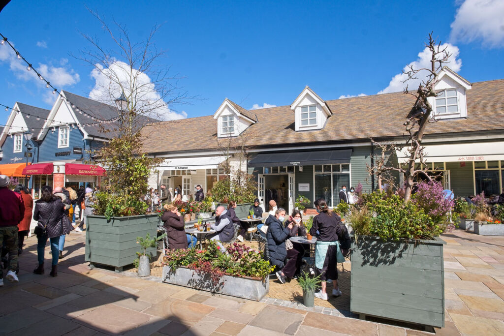 People enjoying some food and refreshments outdoors at Bicester Village