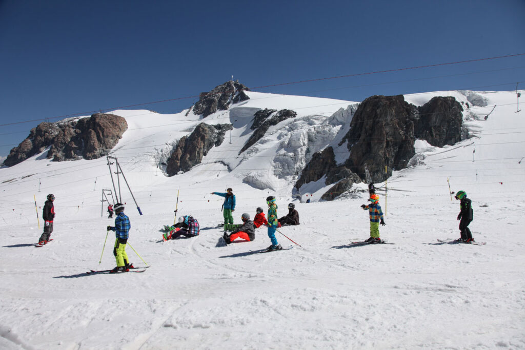 Children practicing their skiing skills on the gentle slopes