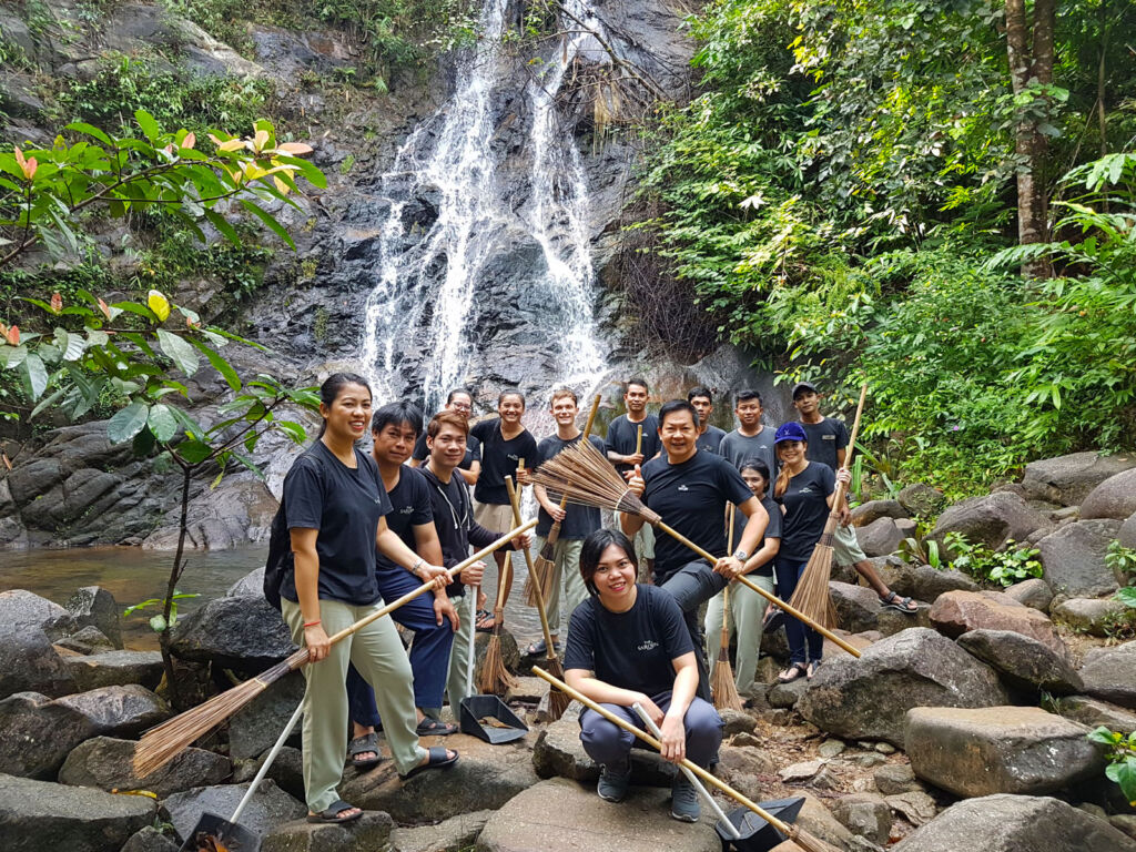 Waterfall cleaning with the resort's staff
