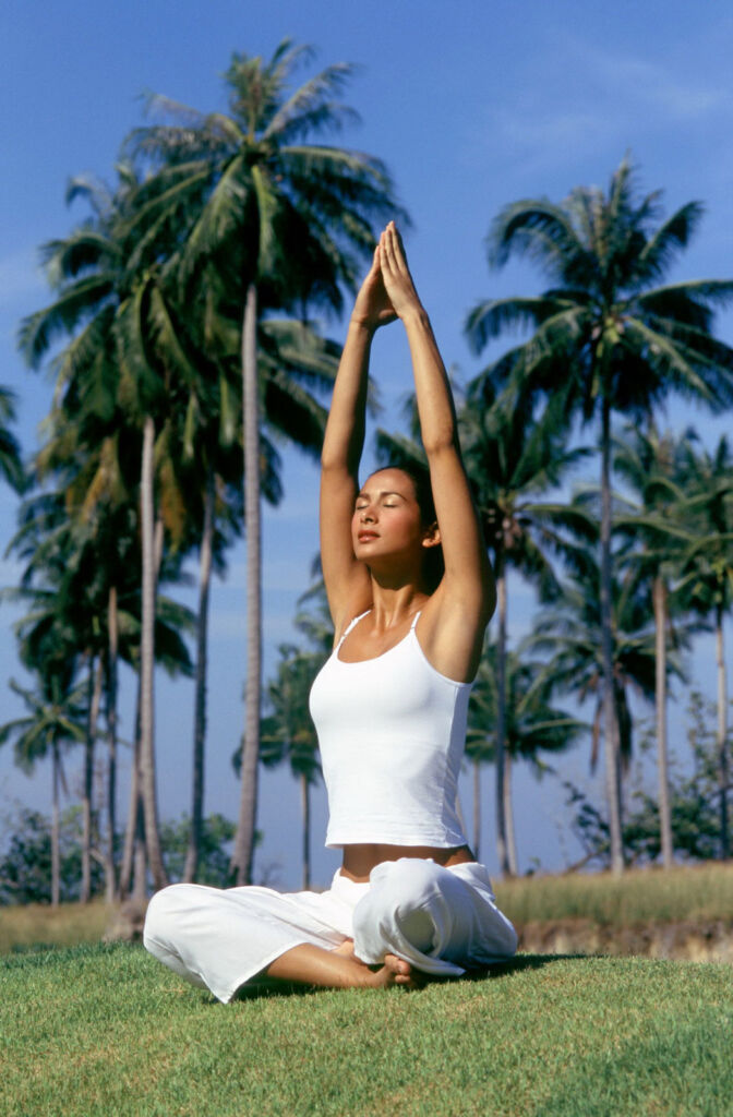 A young woman practicing yoga and meditation